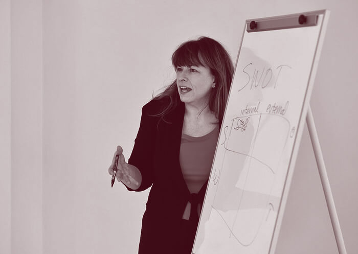 Regenia Bailey consulting at a whiteboard