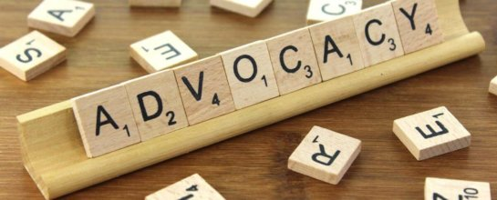 Scrabble tiles that spell advocacy.